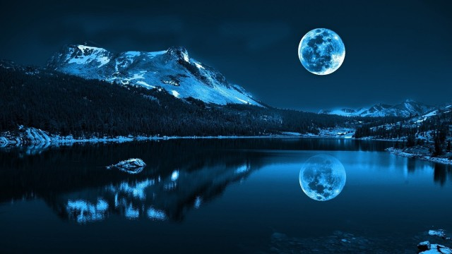 Reflection of snowy mountain on body of water under full moon wallpaper